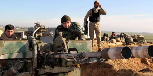 In this Tuesday, Jan. 20, 2015 image released by the Kurdistan Region Security Council (KRSC), Kurdish peshmerga forces prepa