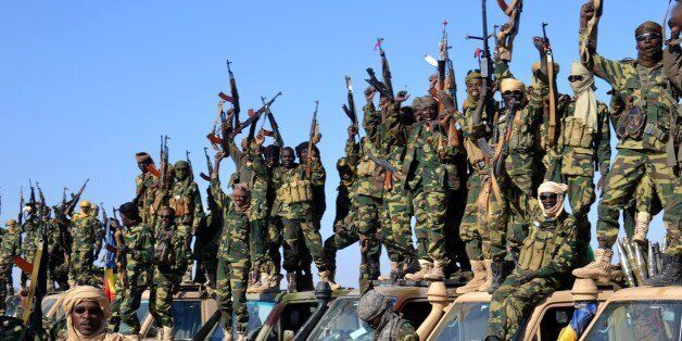 Chadian soldiers gather on February 1, 2015 near the Nigerian town of Gamboru, just accros the border from Cameroon. In a des