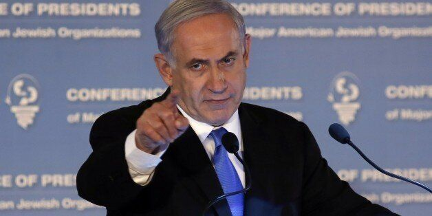 Israeli Prime Minister Benjamin Netanyahu gestures as he delivers a speech during the Presidents Conference of Major American