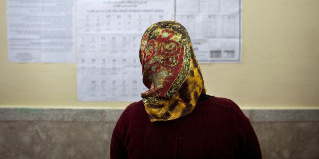 ABU GHOSH, ISRAEL - JANUARY 22: (ISRAEL OUT) A woman looks at the information hung on a wall as Israeli Arabs cast their vote
