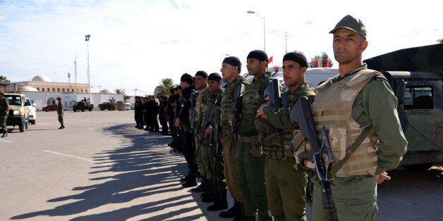 MEDENINE, TUNISIA - DECEMBER 07:  Tunisian security forces take security measures near Raj Jedir border crossing on the Tunis