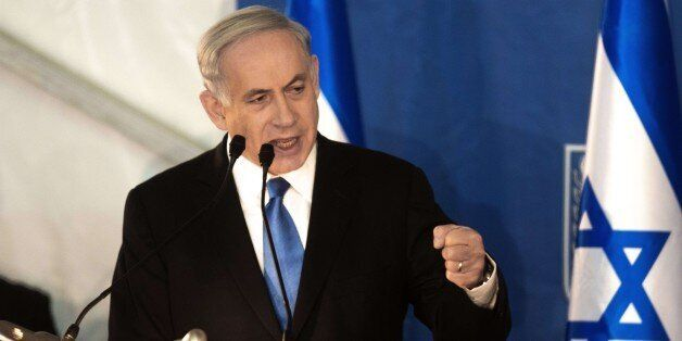 Israeli Prime Minister Benjamin Netanyahu delivers a speech during a swearing-in ceremony for Israel's new Chief of Staff Gad