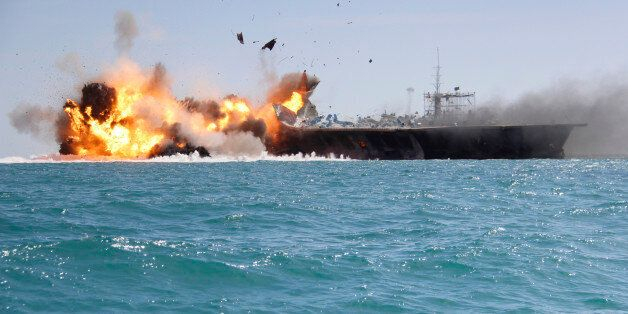 In this picture released by the Iranian Tasnim news agency on Wednesday, Feb. 25, 2015, a replica of a U.S. aircraft carrier