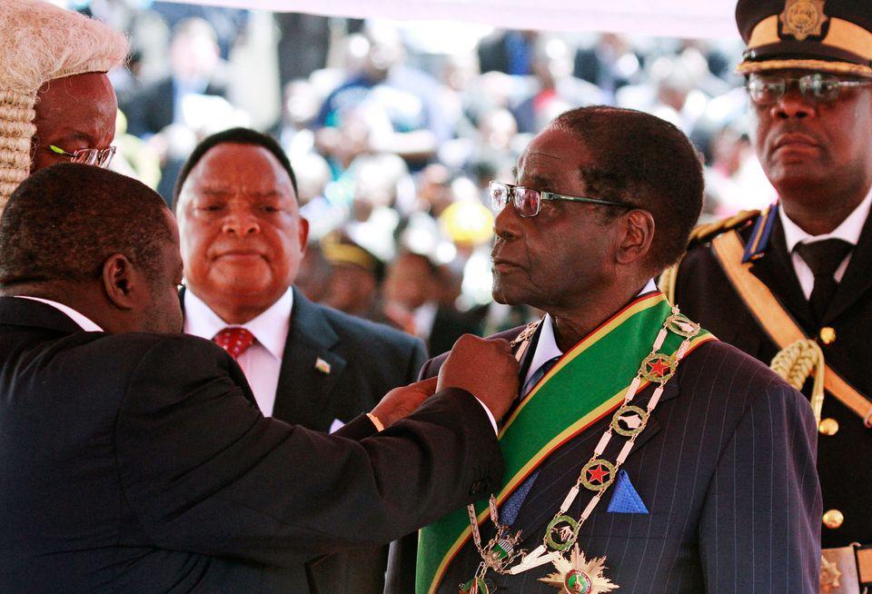 Zimbabwean President Robert Mugabe is inaugurated in Harare, Thursday, Aug. 22, 2013. (AP Photo/Tsvangirayi Mukwazhi)