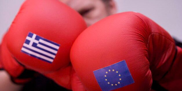 GERMANY, BONN - FEBRUARY 20: Boxer and boxing gloves with the flags of Greece and the EU, on February 20, 2015 in Bonn, Germ