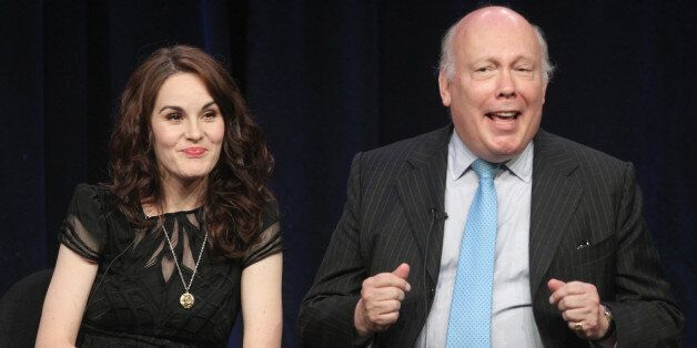 BEVERLY HILLS, CA - JULY 21:  Actors Michelle Dockery (L) and Julian Fellowes speak onstage at the Masterpiece Classic 'Downt