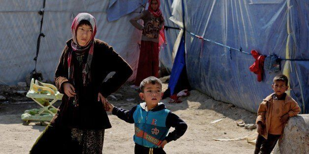 Iraqi refugees who fled from Tikrit and other towns after the advance of Islamic militants, settle at a camp for displaced Ir