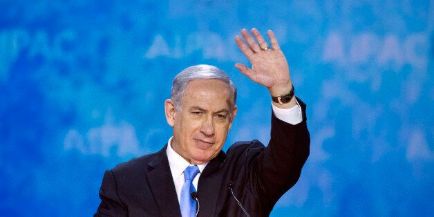 Israeli Prime Minister Benjamin Netanyahu waves at the conclusion of his address to the 2015 American Israel Public Affairs C