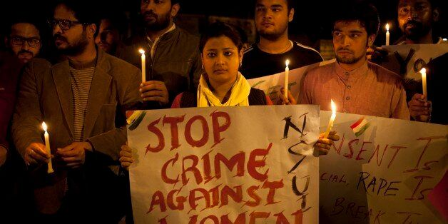 Indian youth hold candles during a protest against sexual violence in New Delhi, India, Monday, Feb. 9, 2015.Police were sear