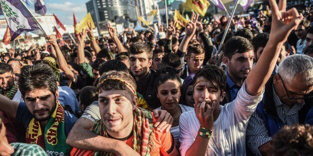 Supporters cheer to Selahattin Demirtas (not pictured), leader of pro-Kurdish Peoples' Democracy Party (HDP), during a rally