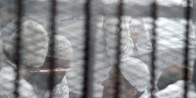 CAIRO, EGYPT - MARCH 05: Defendants seen inside of defendants cage during Ansar Beit Al-Maqdis trial at Police Academy in Tor