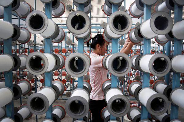 A North Korean woman works at the Kim Jong Suk Pyongyang textile factory, Thursday, July 31, 2014, in Pyongyang, North Korea.