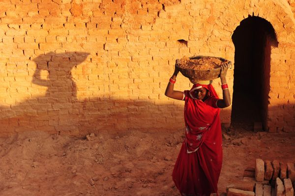 An Indian female laborer works at a brick factory in Allahabad on March 7, 2013. (Sanjay Kanojia/AFP/Getty Images)