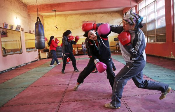In this Wednesday, March, 5, 2014 photo, Afghan women boxers practice at the Kabul stadium boxing club. (Massoud Hossaini/AP)