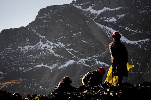 Pallaqueras, female gold miners, search for gold on a load of waste rock from the gold mines on Aug. 4 2012 in La Rinconada,