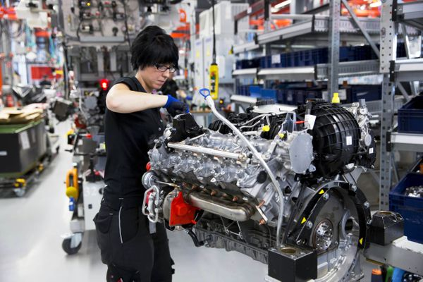 A female engineer hand-builds a M157 5.5L V8 bi-turbo engine at the Mercedes-AMG engine production factory in Affalterbach, G