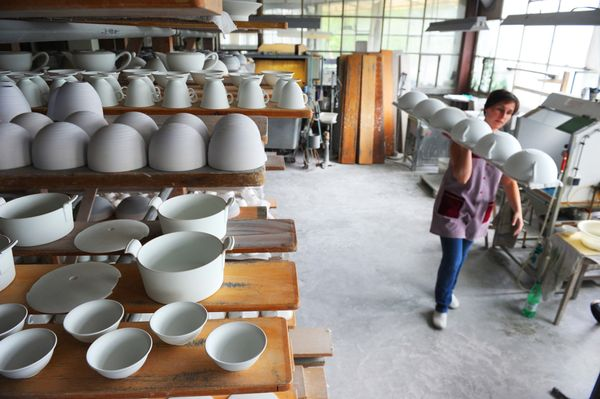 A woman works at a plant of porcelain manufacturing society JL Coquet in Saint-Leonard-de-Noblat near Limoges, France on July
