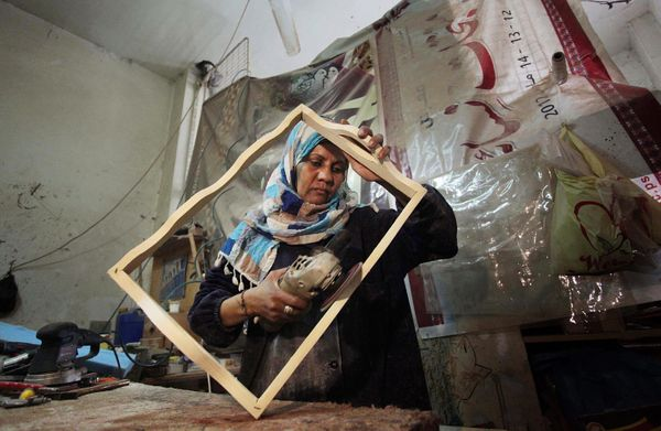 Palestinian woman Amal Abu-Rqayiq works at her small carpentry work-shop in the Nusseirat refugee camp in the Gaza City, Gaza