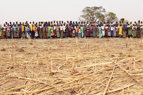 Women taking part in a cash for work program run by the French non-governmental organization Action Against Hunger to build d