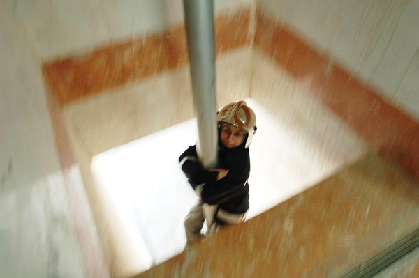 Mahboubeh Khoshsolat, one of the only women's fire and rescue units in the Middle East, slides down the fire pole at Fire Sta