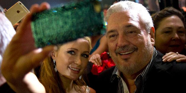 Celebrity Paris Hilton, left, takes a selfie with Fidel Castro Diaz-Balart, son of Cuba's leader Fidel Castro during the gala