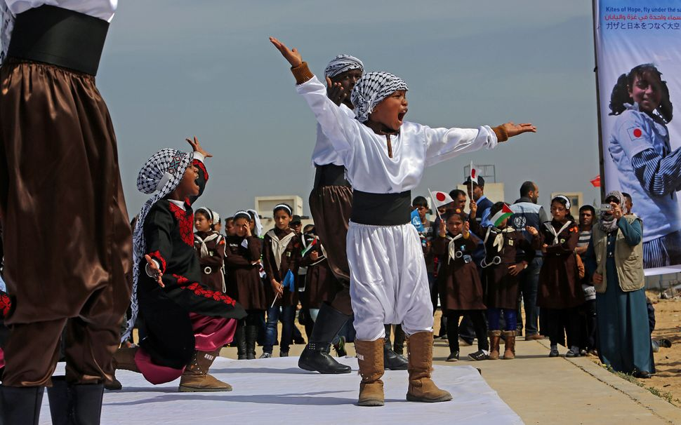 "Palestinian students perform the ""Dabka,"" a traditional Palestinian dance, during a commemoration to mark the fourth annivers"