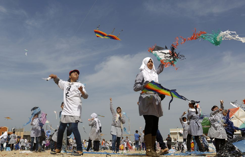 Palestinian school children fly kites to show solidarity with Japan in Khan Younis, Gaza on March 9, 2015.