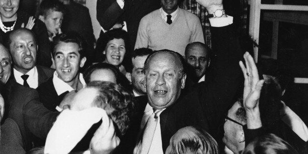 Oskar Schindler, center, is surrounded by holocaust survivors in Jerusalem, Israel on May, 1, 1962.  Upon his arrival, Schind