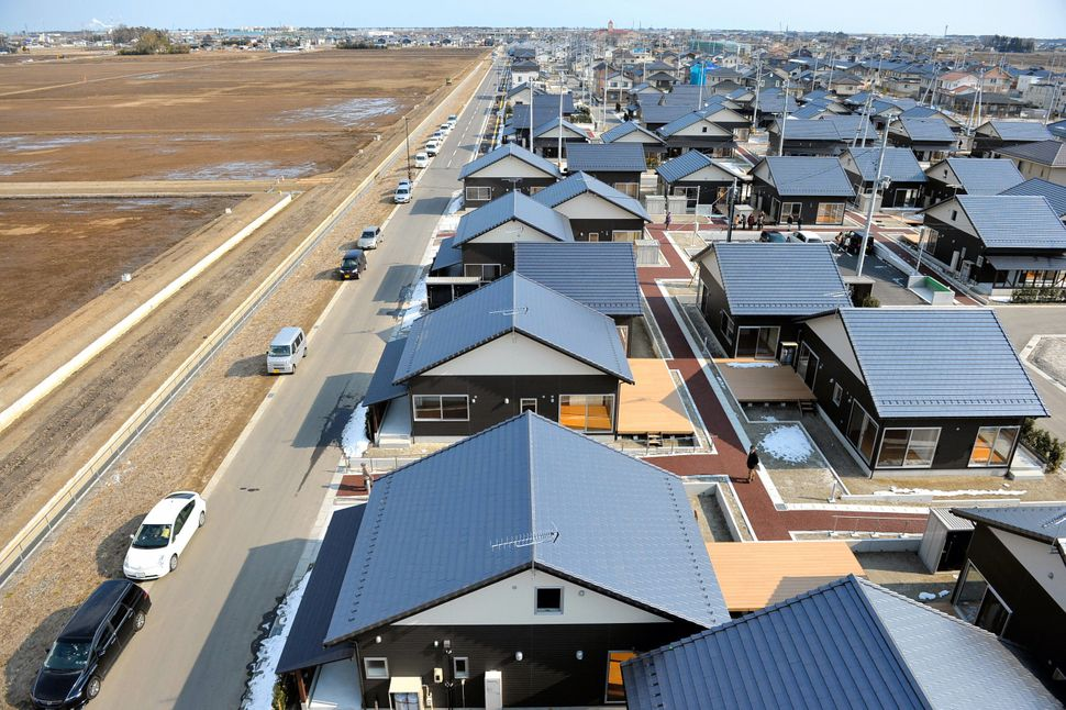 Brand-new houses are seen while land facing the sea remains vacant on Feb. 11, 2015, in Iwanuma, Miyagi, Japan. This is the f
