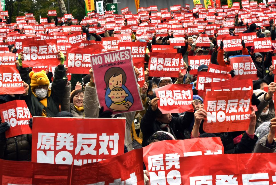 Protestors raise anti-nuclear placards at a rally denouncing nuclear power plants in Tokyo on March 8, 2015. Thousands of peo