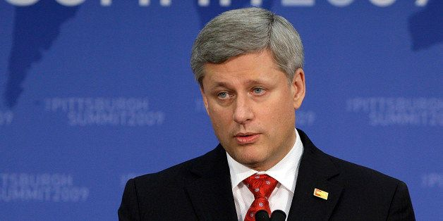 Canadian Prime Minister Steven Harper answers questions during a news conference at the conclusion of the G-20 summit, Friday