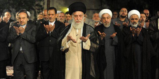 TEHRAN, IRAN - JULY 14:  Supreme Leader of Iran Ali Khamenei (C) meets with president of Iran Hassan Rouhani (2th R) and cabi
