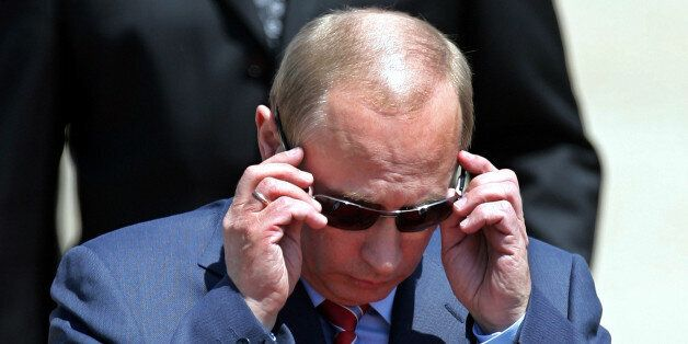 Russia's President Vladimir Putin puts his sunglasses on upon arrival at Zagreb airport, Sunday, June 24, 2007. President Put