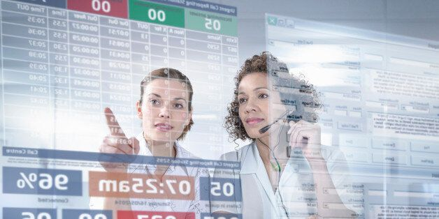 Customer service operators looking at interactive screen