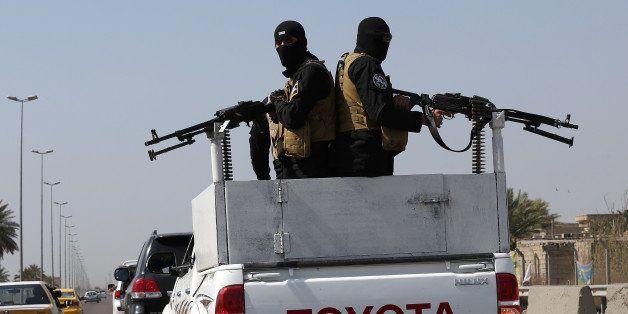 Members of Peace Brigades, a Shiite militia group loyal to Shiite cleric Muqtada al-Sadr, heading to Tikrit, where Iraqi troo