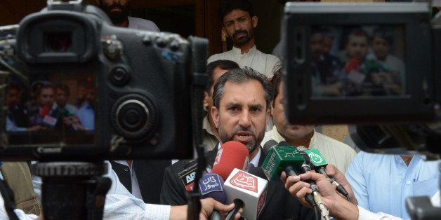 Samiullah Afridi (C), lawyer for Pakistani doctor Shakeel Afridi, who assisted the CIA in their hunt for Osama bin Laden, spe
