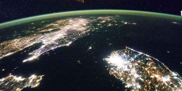 """Flying over East Asia, an Expedition 38 crew member on the International Space Station took this night image of the Korean Peninsula. Unlike daylight images, city lights at night illustrate dramatically the relative economic importance of cities, as gauged by relative size. In this north-looking view, it is immediately obvious that greater Seoul is a major city and that the port of Gunsan is minor by comparison. There are 25.6 million people in the Seoul metropolitan area-more than half of South Korea's citizens-while Gunsan's population is 280,000. North Korea is almost completely dark compared to neighboring South Korea and China. The darkened land appears as if it were a patch of water joining the Yellow Sea to the Sea of Japan. The capital city, Pyongyang, appears like a small island, despite a population of 3.26 million (as of 2008). The light emission from Pyongyang is equivalent to the smaller towns in South Korea. Coastlines are often very apparent in night imagery, as shown by South Korea's eastern shoreline. But the coast of North Korea is difficult to detect. These differences are illustrated in per capita power consumption in the two countries, with South Korea at 10,162 kilowatt hours and North Korea at 739 kilowatt hours. Image credit: NASA Original image: <a href=""""http://www.flickr.com/photos/nasa2explore/12752402055/in/set-72157629601396498"""" role=""""link"""" rel=""""nofollow"""" class="""" js-entry-link cet-external-link"""" data-vars-item-name=""""www.flickr.com/photos/nasa2explore/12752402055/in/set-721..."""" data-vars-item-type=""""text"""" data-vars-unit-name=""""5cc1477fe4b0328602bc1444"""" data-vars-unit-type=""""buzz_body"""" data-vars-target-content-id=""""http://www.flickr.com/photos/nasa2explore/12752402055/in/set-72157629601396498"""" data-vars-target-content-type=""""url"""" data-vars-type=""""web_external_link"""">www.flickr.com/photos/nasa2explore/12752402055/in/set-721...</a> More about space station research: <a href=""""http://www.nasa.gov/mission_pages/station/research/index.html"""" role=""""link"""""""