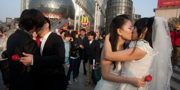 In a picture taken on March 8, 2011 gay couples kiss during their ceremonial 'wedding' as they try to...