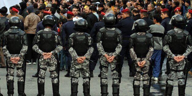 The Jordanian security surrounds the demonstration of the Muslim Brotherhood in downtown Amman, Jordan, Jordan, Friday, Nov.