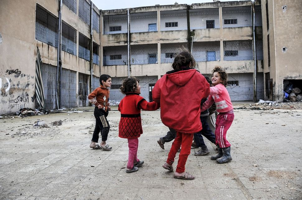 Kids playing in a yard of a destroyed building in the center of the Syrian town of Kobani (Ayn al-Arab), on Feb. 18, 2015.