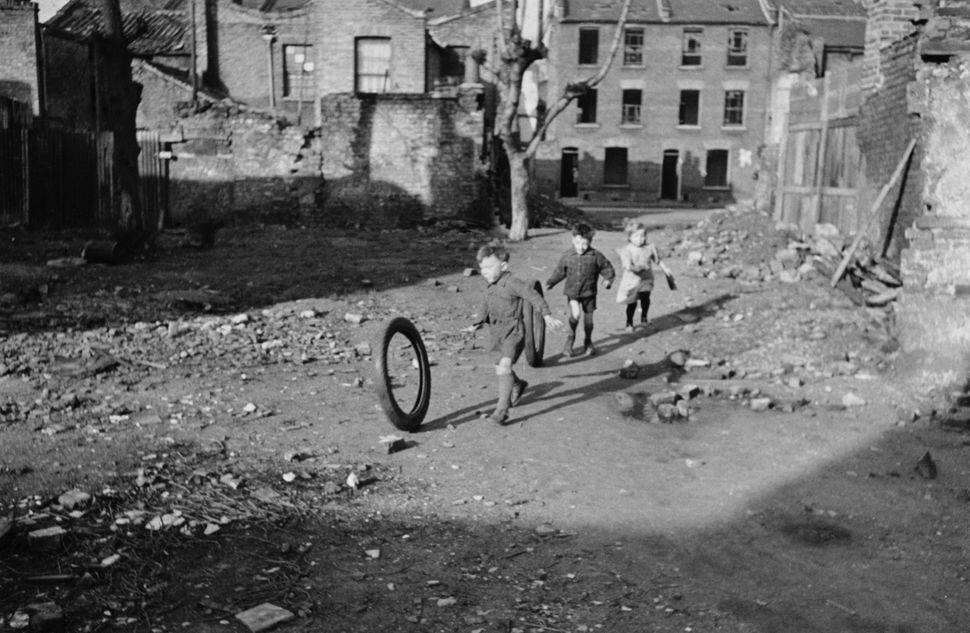 Children playing in an area of bomb-damaged wasteground in Stepney, in the East End of London, March 9, 1946.