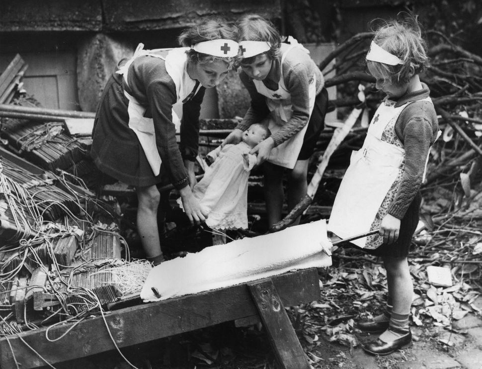 Young daughters of air raid wardens in south-east London practicing first aid with their dolls in WW II on Oct. 6, 1940.