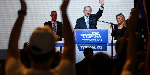 FILE - In this March 17, 2015 file photo, Israeli Prime Minister Benjamin Netanyahu greets supporters at the party's election