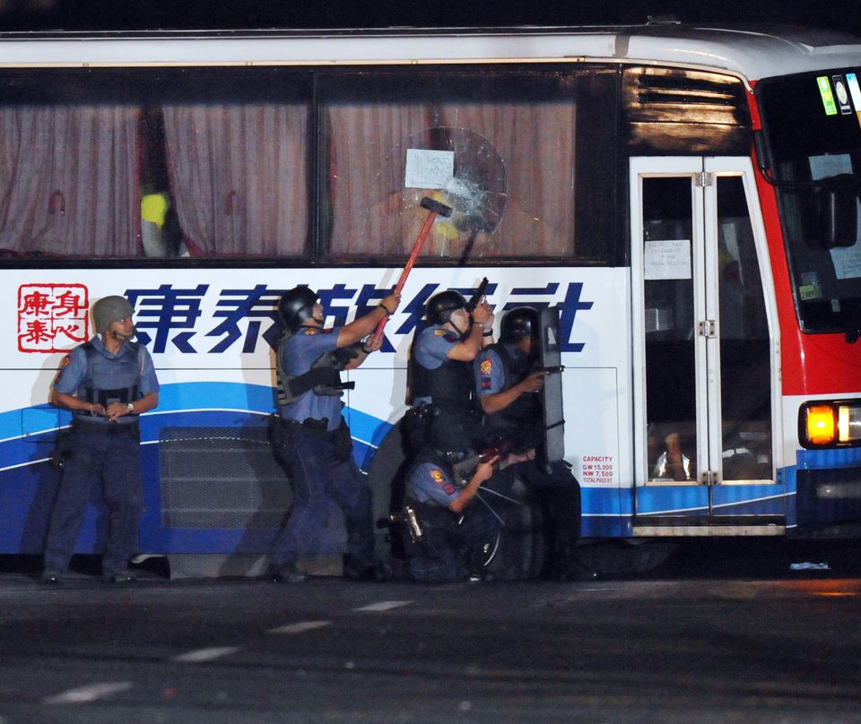 Policemen take position as they start their attack on the bus.