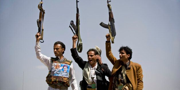 Supporters of Ahmed Ali Abdullah Saleh, the son of Yemeni former President Ali Abdullah Saleh, hold their weapons as they cha