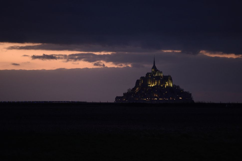 View of the Mont Saint-Michel and its Gothic Benedictine abbey on March 21, 2015 at sunset, as driven by the effects of the s
