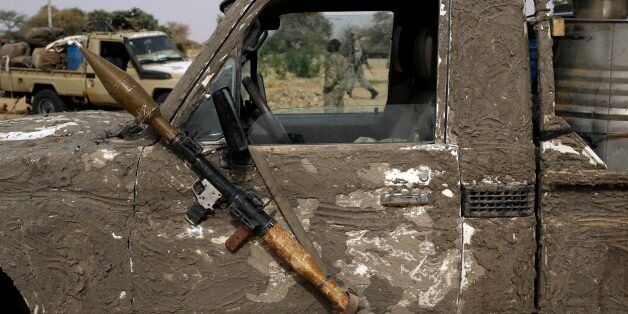A rocket propelled launcher hangs on the mirror of a camouflaged Chadian pickup truck in the Nigerian city of Damasak, Nigeri