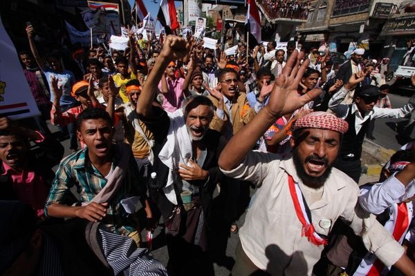 Yemeni protesters shout slogans against Houthi Shiites who have seized power in the capital, Sanaa, as they celebrate the fou
