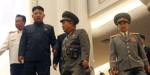 FILE - In this July 27, 2013 file photo, North Korean leader Kim Jong Un, second left, flanked by Yang Hyong Sop, right, vice president of the Presidium of North Korea's parliament, and Choe Ryong Hae, vice Marshal, left, as he tours the newly opened Fatherland Liberation War Museum as part of celebrations for the 60th anniversary of the Korean War armistice in Pyongyang, North Korea. A campaign within the United Nations to haul North Korean leader Kim Jong Un before an international court for crimes against humanity has touched off a defensive fury in Pyongyang, where it's being treated like a diplomatic declaration of war - an aggressive act aimed not only at shutting down prison camps but also at removing Kim and dismantling his family's three-generation cult of personality. (AP Photo/Wong Maye-E, File)