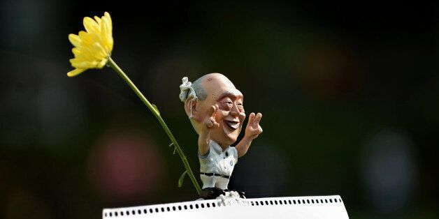 A Caricature of former Singapore prime minister Lee Kuan Yew is displayed during a rally at a free-speech park called Speaker